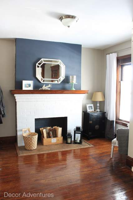 An old house fireplace gets a mini paint makeover with a hale navy accent wall. Hale navy by Benjamin Moore paint.
